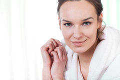 Woman wearing bathrobe Stock Photos