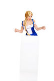 Woman wearing Bavarian dress holding empty banner. Stock Photos