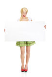 Woman wearing Bavarian dress holding empty banner. Royalty Free Stock Photo