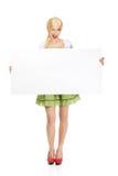 Woman wearing Bavarian dress holding empty banner. Royalty Free Stock Photo