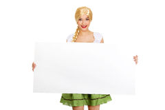 Woman wearing Bavarian dress holding empty banner. Stock Image