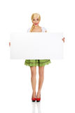 Woman wearing Bavarian dress holding empty banner. Stock Photo