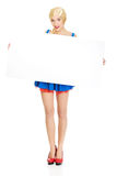 Woman wearing Bavarian dress holding empty banner. Royalty Free Stock Photos
