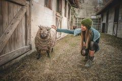 Woman Wearing Beanie Beside Sheep Royalty Free Stock Photos