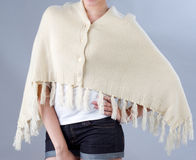 Woman wearing a beige knitted scarf Royalty Free Stock Photos