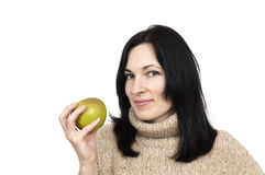 Woman wearing beige sweater holding apple Royalty Free Stock Photos