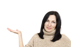 Woman wearing beige sweater holding arm palm up Stock Photography