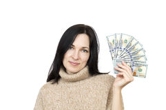 Woman wearing beige sweater holding money. Isolated over white Royalty Free Stock Image