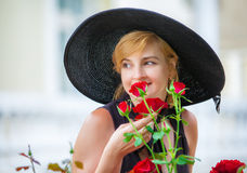 Woman wearing big black hat Stock Photography