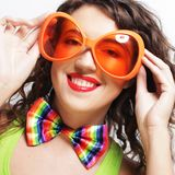 Woman wearing big bright sunglasses Royalty Free Stock Photography