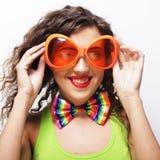 woman wearing big bright sunglasses Stock Photo