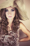 Woman wearing big hat Stock Photography