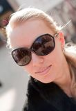 Woman wearing the big modern sunglasses. Royalty Free Stock Photography