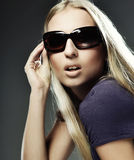 Woman wearing the big modern sunglasses Stock Photos