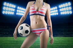 Woman wearing bikini with a ball on field 1 Stock Photos