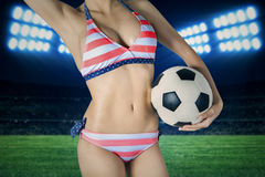 Woman wearing bikini with a ball on field Stock Photos