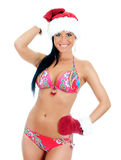 Woman wearing bikini and christmas hat Royalty Free Stock Images