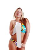 Woman wearing a bikini holding a sash Royalty Free Stock Photos