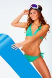 Woman wearing bikini and snowboard. Brunette sexual woman wearing bikini and holding snowboard Stock Images