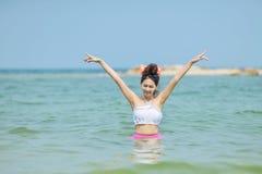 Woman wearing bikini standing at the sea. stock photo