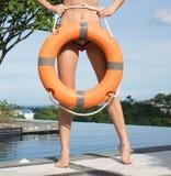 Woman wearing bikini at the swimming pool. Holding ring buoy lifebuoy Royalty Free Stock Image