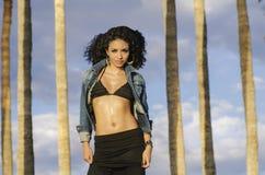 Woman wearing bikini top in tropical location Stock Images