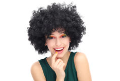 Woman wearing black afro wig Stock Images