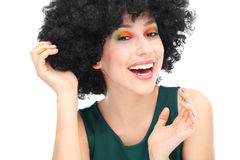 Woman wearing black afro wig. Woman wearing wig over white background Stock Images
