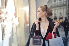 Woman Wearing Black Blazer Holding Shopping Bags Royalty Free Stock Photography