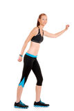 Woman wearing black blue zumba fitness outfit. On white background Royalty Free Stock Image