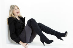 Woman wearing black boots Royalty Free Stock Photos