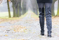 Woman wearing black boots Stock Photo