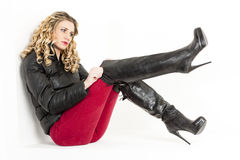 Woman wearing black boots Royalty Free Stock Images