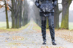 Woman wearing black clothes and boots Stock Photography