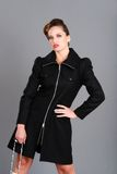 Woman wearing black coat Royalty Free Stock Photography