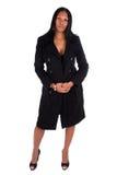 Woman wearing black coat. Full length portrait of an African American woman wearing a black coat Royalty Free Stock Image