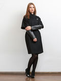 Woman wearing black coat with leather sleeves Stock Photos