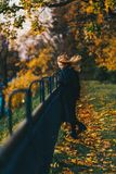 Woman Wearing Black Coat Near Railings Royalty Free Stock Images
