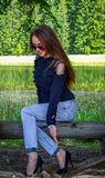 Woman Wearing Black Cold-shoulder Top and Blue Denim Jeans stock photography