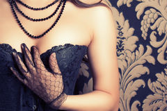 Woman wearing black corset Royalty Free Stock Images