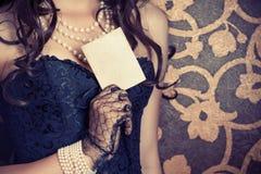 Woman wearing black corset Stock Image