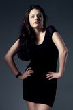Woman wearing black dress Royalty Free Stock Photography