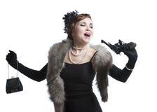 Woman wearing a black dress with gun Royalty Free Stock Photos