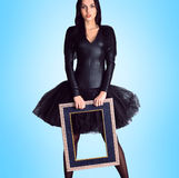 Woman wearing in black dress holding picture frame Royalty Free Stock Image
