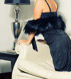 Woman wearing in black dress and luxury fur boa Royalty Free Stock Photos