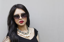 Woman wearing black dress and sunglasses Stock Photo