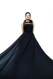 Woman wearing black evening dress Stock Photos