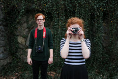 Woman Wearing a Black and Gray Stripes Shirt and Man Wearing a Green Sweater Taking a Camera Shot Royalty Free Stock Photos