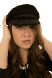 Woman wearing black hat with a somber look. Brunette woman model wearing a black hat with a somber facial expression Royalty Free Stock Photography