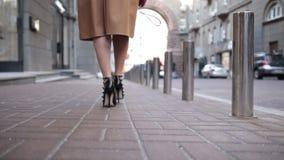 Woman wearing black high heels shoes walking away stock video